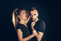 Portrait of stylish young couple, pretty woman and handsome man. Close up portrait of stylish young couple, pretty women in black dress and man, wearing black t Stock Images