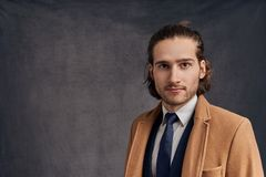 Portrait of a stylish young handsome long-haired unshaven man royalty free stock photos