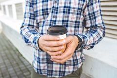 Portrait of stylish young man with cup of coffee. Stock Images