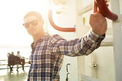 Portrait of stylish young man on ferryboat Royalty Free Stock Image
