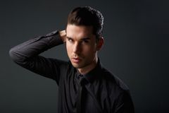 Portrait of a stylish young man with hand in hair Royalty Free Stock Photography
