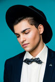Portrait of a stylish young man in hat wearing elegant suit. Stock Images