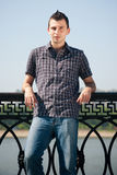 Portrait of stylish young man outdoors Stock Images