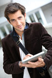 Portrait of stylish young man with tablet Royalty Free Stock Images