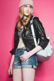 Portrait of stylish young woman in leather jacket with backpack Royalty Free Stock Images
