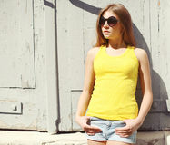 Portrait of stylish young woman wearing a sunglasses and t-shirt Stock Photography