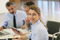 Portrait of succesful businesswoman amongst the team Stock Image