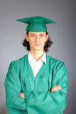 Portrait of a succesful man on his graduation day. In green clothes and a hat Royalty Free Stock Image