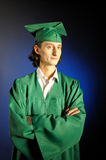 Portrait of a succesful man on his graduation day. In green clothes and a hat Royalty Free Stock Images