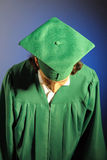 Portrait of a succesful man on his graduation day. In green clothes and a hat Stock Photos