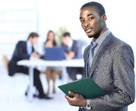 Portrait of a successful american african businessman smiling leading his team Royalty Free Stock Images