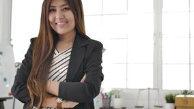 Portrait of successful asian Businesswoman entrepreneur working at busy office smiling stock video footage