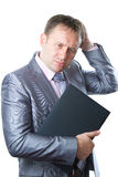 Portrait of successful business man in a stylish suit works laptop Stock Image
