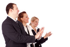 Portrait of successful business people clapping. Isolated over white background Stock Images