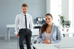 Portrait of Successful Business People at their Workplace. Busin Stock Image