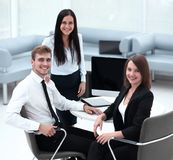 Portrait of successful business team near the desktop. Successful business team near the desktop . photo with copy space Royalty Free Stock Images
