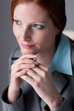 Portrait of successful business woman. At office holding pen Royalty Free Stock Photos