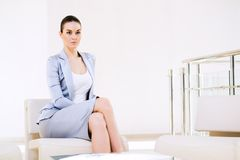 Portrait successful business woman. Successful business woman sitting in the office, ready for the meeting Royalty Free Stock Photo