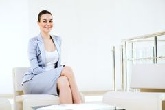 Portrait successful business woman. Successful business woman sitting in the office, ready for the meeting Royalty Free Stock Photography