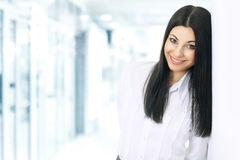 Portrait of a successful business woman on the background  bright office Stock Photo