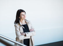 Portrait of successful business woman on a light office background. Successful business woman on a light office background. Photo has empty space for your text Stock Images