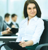 Portrait of successful business woman in office on the backgroun Royalty Free Stock Image