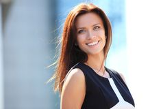 Portrait of a successful business woman smiling. Beautiful young female executive in an urban setting Royalty Free Stock Image