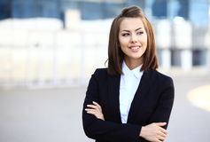 Portrait of a successful business woman smiling. royalty free stock image