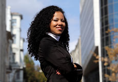 Portrait of successful business woman on the street. Smiling business woman portrait outdoors, with modern building as background Stock Image