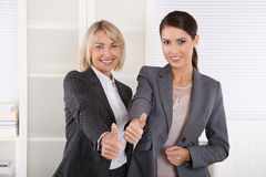 Portrait: Successful business woman team making thumbs up gestur Stock Image