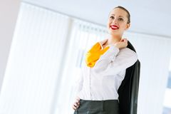 Portrait of a successful business woman. Threw a jacket over his shoulder Royalty Free Stock Images