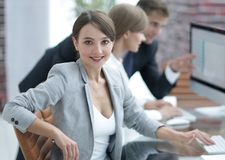 Portrait of successful business women in the workplace. Portrait of successful business women on the background of the workplace Stock Photos