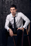 Portrait of successful businessman on a chair. Exudes confidence Royalty Free Stock Images