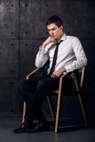 Portrait of successful businessman on a chair. Successful businessman on a chair is thinking about his business Stock Photos
