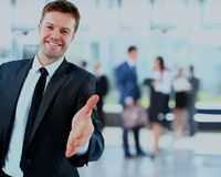 Portrait of a successful businessman giving a hand. Portrait of a successful businessman giving a hand Royalty Free Stock Images