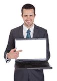 Portrait of successful businessman with laptop Stock Photos