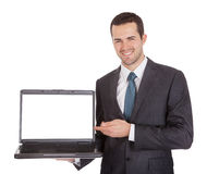 Portrait of successful businessman with laptop Stock Photography
