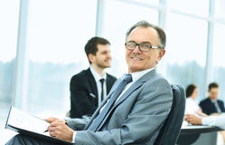 Portrait of a successful businessman in the office on the background of team work Stock Photography