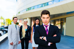 Portrait of a successful businessman. Outdoors standing with his colleagues Royalty Free Stock Images