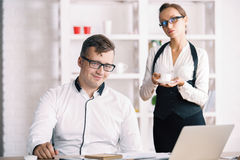 Portrait of successful businessman with secretary Stock Photography