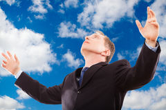 Portrait of successful businessman in sky. Royalty Free Stock Photo