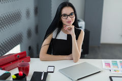 Portrait of successful businesswoman behind the desk in the office Royalty Free Stock Photos