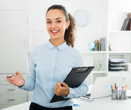 Portrait of successful businesswoman holding pad documents royalty free stock photo