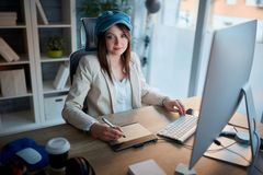 Portrait of successful business woman is devoted to her career a. Portrait of successful casual business woman is devoted to her career and working late on stock image