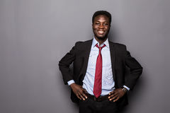 Portrait of a successful confident african businessman professional in a smart formal suit isolated Stock Images