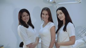 Portrait of successful, confident dentists look at camera at dental room. 4K stock footage