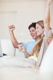 Portrait of a successful couple shopping online Stock Images
