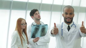 Portrait of a successful doctor showing two thumbs stock video footage