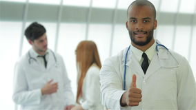 Portrait of a successful doctor showing two thumbs stock video