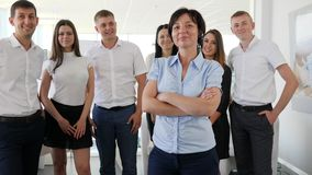 Portrait of Successful Executive stand on background business team in room stock footage
